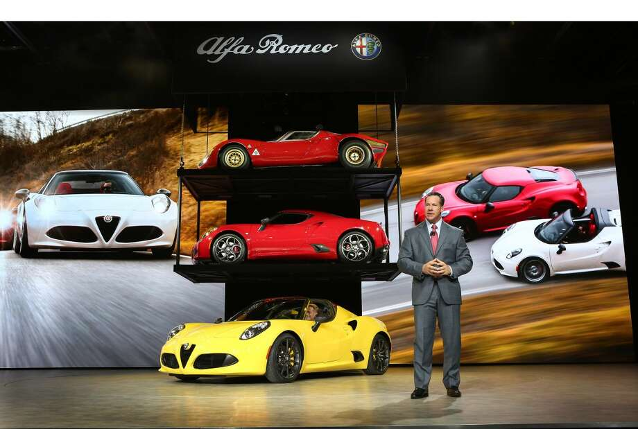 All-New 2015 Alfa Romeo 4C Spider World Premier Detroit - January 12, 2015 - Reid Bigland, Head of Alfa Romeo North America, unveiled the all-new 2015 Alfa Romeo 4C Spider at the North American International Auto Show today. Alfa Romeo 4C Spider delivers race-inspired performance, advanced technologies, seductive Italian style and now, an even more exhilarating driving experience with open-air freedom. Alfa Romeo 4C expands the brand's product offering and will arrive this summer in dealerships in North America. (PRNewsFoto/FCA US LLC)