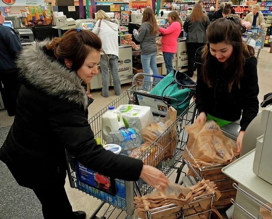 Tanaz Rahin and her mother Farri Rahin of Charleston, W.Va., drove across town to the Kroger in South Charleston, W.Va., to find water following a chemical spill on the Elk River that compromised the public water supply to eight counties on Thursday, Jan. 9, 2014. (AP Photo/Tyler Evert) / FR170609 AP