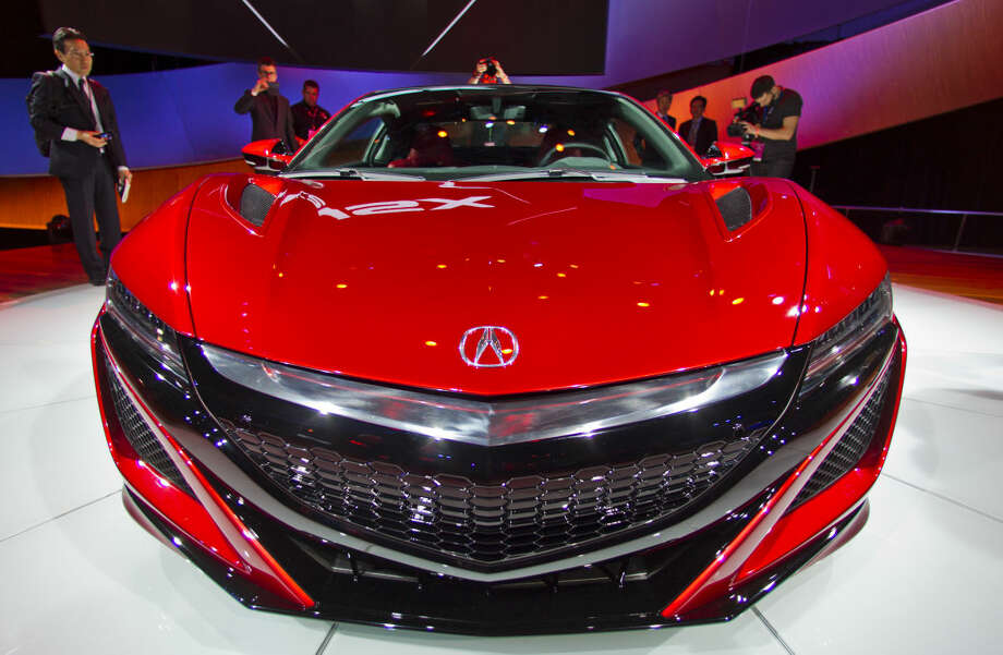 The bonnet of the new Acura NSX, on display at the North American International Auto Show, Monday, Jan. 12, 2015, in Detroit. (AP Photo/Tony Ding)