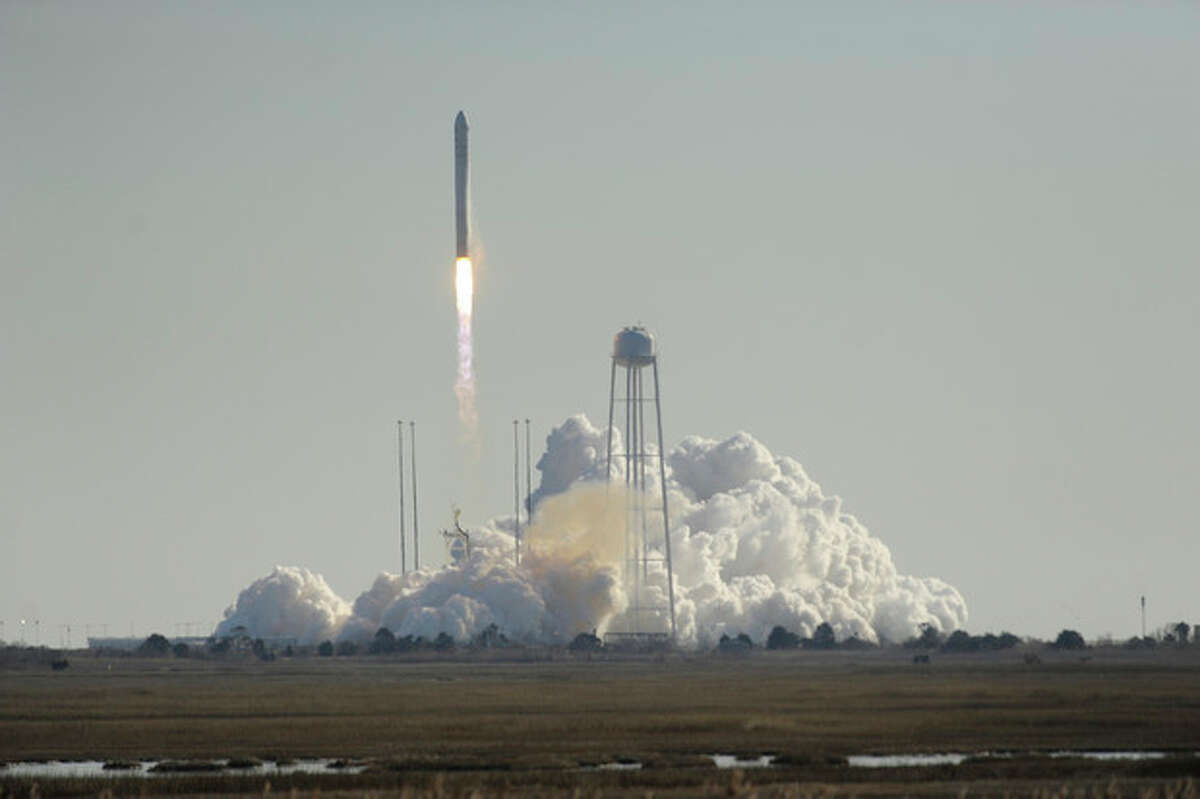 Orbital Science Corps.' Antares rocket lifts off from Wallops Island, Va. on Thursday, Jan. 9, 2014. The rocket is carrying the company's first official re-supply mission to the International Space Station. (AP Photo/Eastern Shore News, Jay Diem) NO SALES