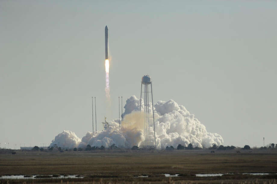 Orbital Science Corps.' Antares rocket lifts off from Wallops Island, Va. on Thursday, Jan. 9, 2014. The rocket is carrying the company's first official re-supply mission to the International Space Station. (AP Photo/Eastern Shore News, Jay Diem) NO SALES / Eastern Shore News