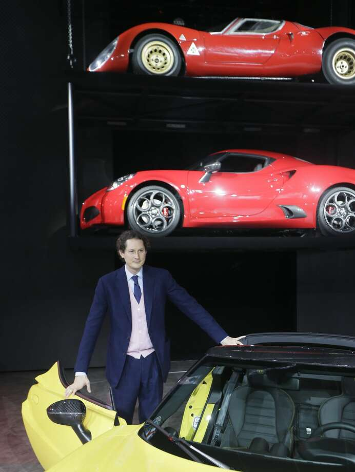 Chairman of Fiat Chrysler Automobiles John Elkann stands by the Alfa Romeo 4C Spider during the North American International Auto Show, Monday, Jan. 12, 2015 in Detroit. (AP Photo/Carlos Osorio)