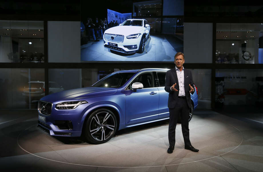 Hakan Samuelsson, President and CEO of Volvo Car Group, speaks in front of an XC90 at media previews for the North American International Auto Show in Detroit Monday, Jan. 12, 2015. (AP Photo/Paul Sancya)