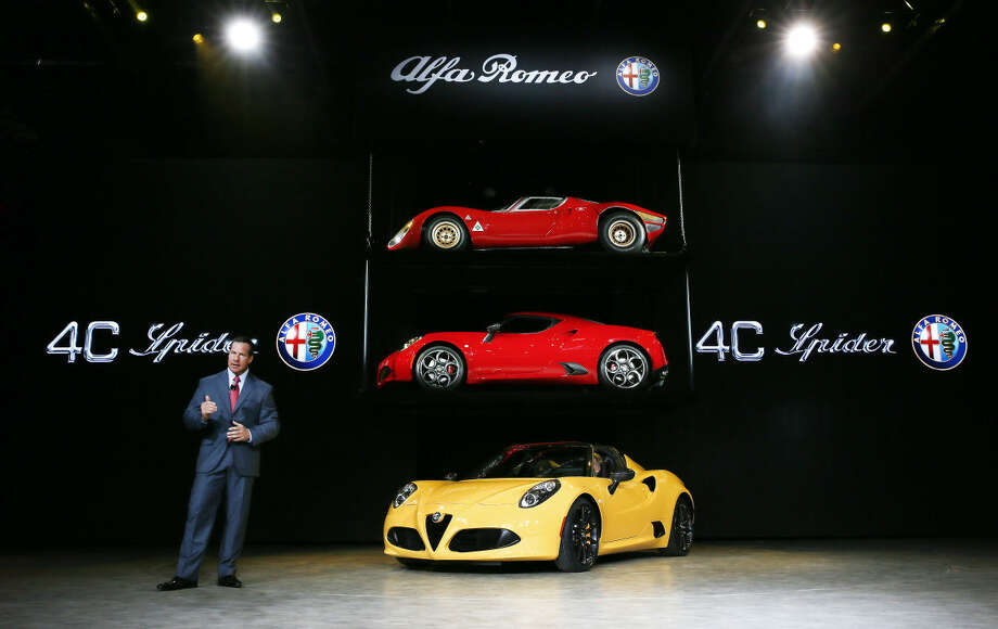 Reid Bigland, President and CEO, Alfa Romeo, North America, introduces the Alfa Romeo 4C Spider at media previews for the North American International Auto Show in Detroit Monday, Jan. 12, 2015. (AP Photo/Paul Sancya)
