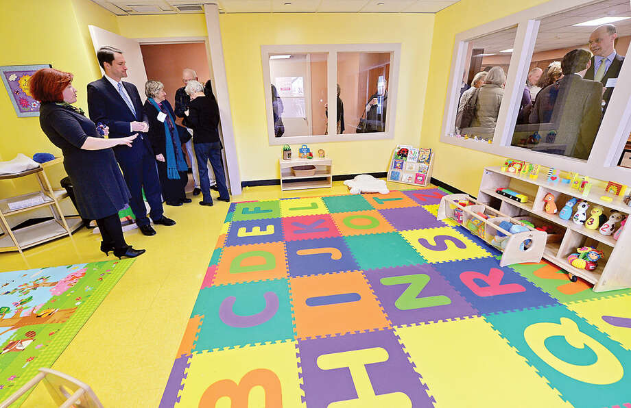 Congressman Jim Himes gets a tour of Inspirica's new Early Childhood and Parenting Program space from program director Barbara McLaughlin.