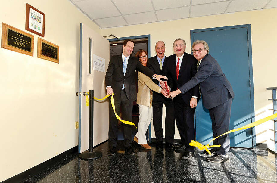 Congressman Jim Himes, Saint Josephs Parenting Center Executive Director Measi O'Rourke, Inspirica CEO Jason Shaplen, Mayor David Martin and Childcare Learning Center CEO Marc Jaffe cut the ribbon during an opening reception for Inspirica's new Early Childhood and Parenting Program.