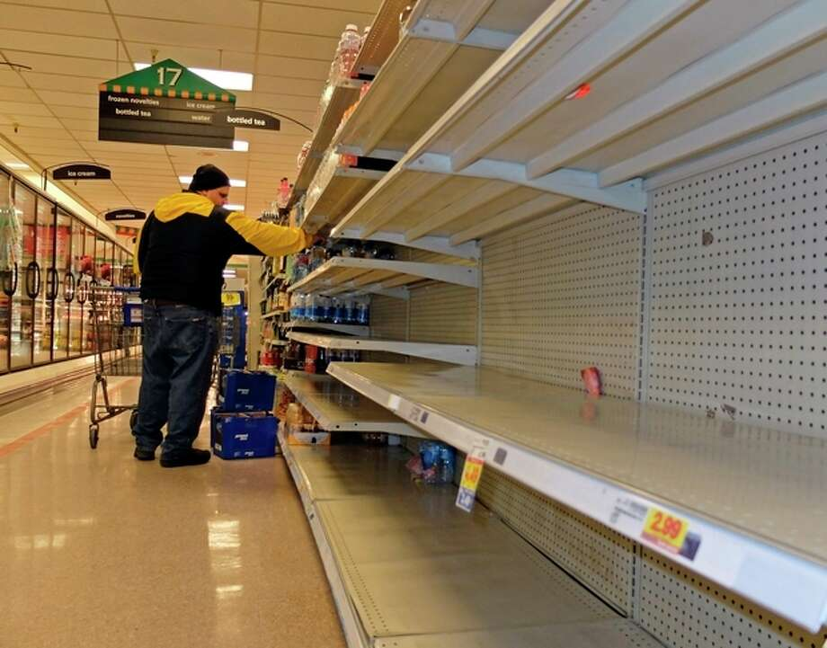 Jim Cole of Exeter, N.H., got the last few bottles of water at the Kroger in South Charleston W.Va. following a chemical spill on the Elk River that compromised the public water supply to eight counties of Thursday, Jan. 9, 2014. (AP Photo/Tyler Evert) / FR170609 AP