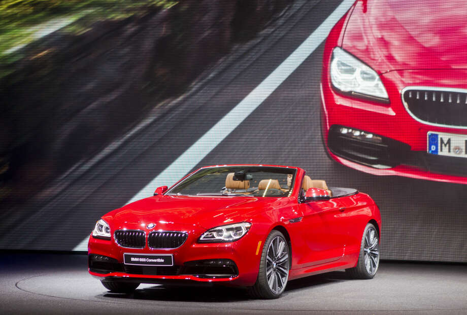 The BMW 6 series convertible is unveiled at the North American International Auto Show, Monday, Jan. 12, 2015, in Detroit. (AP Photo/Tony Ding)