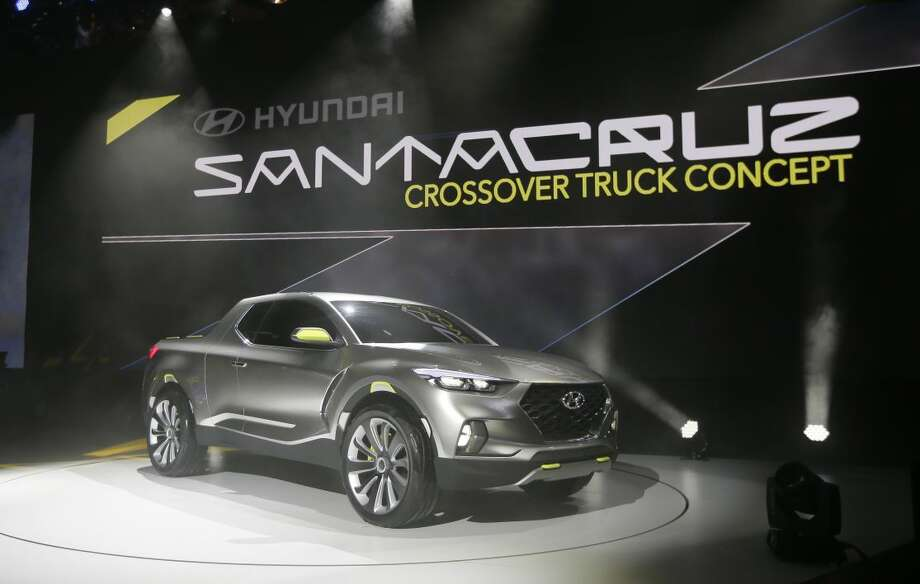 The Hyundai Santa Cruz crossover truck concept is unveiled during the North American International Auto Show, Monday, Jan. 12, 2015 in Detroit. (AP Photo/Carlos Osorio)