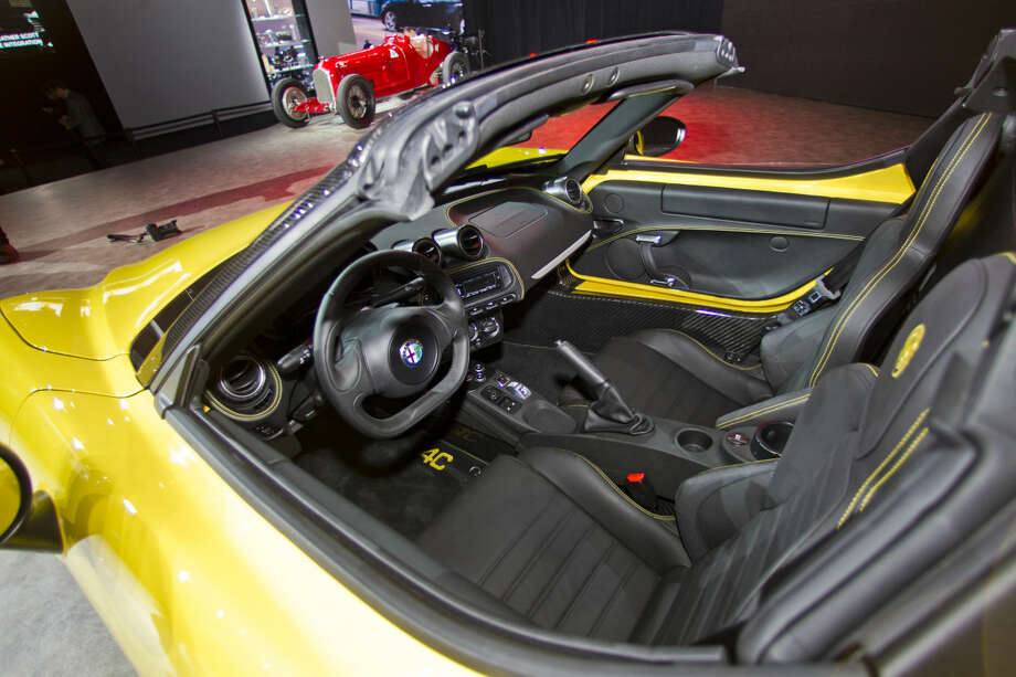 An interior view of an Alfa Romeo 4C Spider convertible, on display at the North American International Auto Show, Monday, Jan. 12, 2015, in Detroit. (AP Photo/Tony Ding)