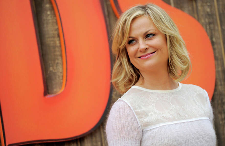 """FILE - In this Oct. 13, 2013 file photo, Amy Poehler, a cast member in """"Free Birds,"""" poses for photographers at the world premiere of """"Free Birds"""" at the Regency Village Theater, in Los Angeles. """"Saturday Night Live"""" alumni Poehler says her old show's hire of young comic Sasheer Zamata is awesome. Zamata and two new writers were hired at NBC's longtime comedy show last week. (Photo by Chris Pizzello/Invision/AP, File) / Invision"""