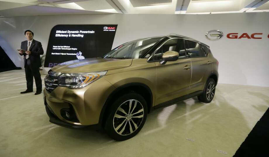 The GAC GS4, from China, is unveiled during the North American International Auto Show, Monday, Jan. 12, 2015 in Detroit. (AP Photo/Carlos Osorio)