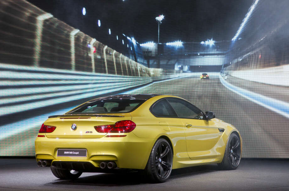 The BMW M6 coupe is unveiled at the North American International Auto Show, Monday, Jan. 12, 2015, in Detroit. (AP Photo/Tony Ding)