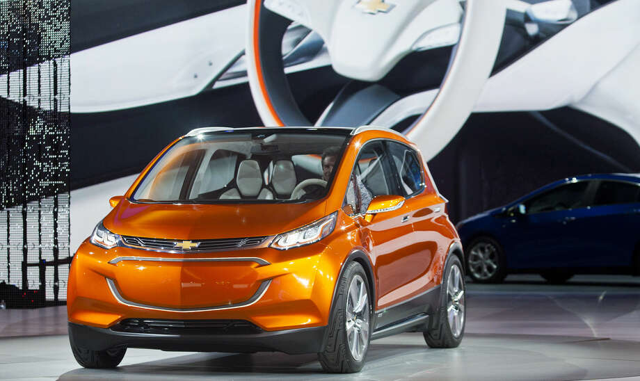 The Chevrolet Bolt EV electric concept vehicle is unveiled during the North American International Auto Show, Monday, Jan. 12, 2015, in Detroit. (AP Photo/Tony Ding)