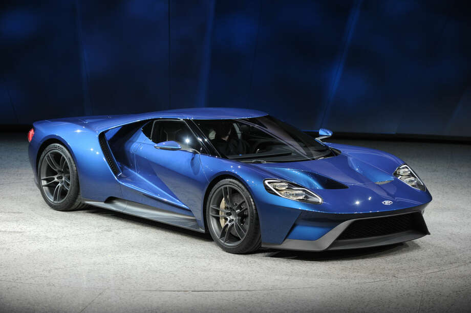 Ford unveiled the Ford GT, a super car that will go into production next year, at the North American International Auto Show in a special unveiling inside Joe Louis Arena Downtown Detroit Monday Jan. 12, 2015. (AP Photo/The Grand Rapids Press, Tanya Moutzalia)