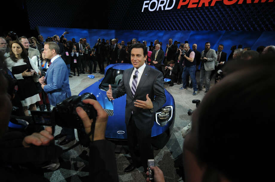 Ford CEO Mark Fields speaks to media after the unveiling of the Ford GT, a super car that will go into production next year, at the North American International Auto Show in a special unveiling inside Joe Louis Arena Downtown Detroit Monday Jan. 12, 2015. (AP Photo/The Grand Rapids Press, Tanya Moutzalia)