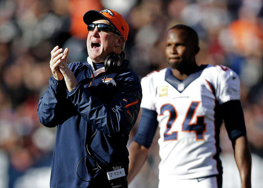 FILE - In this Dec. 29, 2013, file photo, Denver Broncos head coach John Fox celebrates in front of defensive back Champ Bailey after quarterback Peyton Manning threw a 63-yard touchdown pass to wide receiver Demaryius Thomas during the second quarter of an NFL football game against the Oakland Raiders in Oakland, Calif. Since returning from his heart operation last month, Fox seems like a new man. More pep in his step, more color in his face, more boom in his voice. Even more gumption in his calls. (AP Photo/Marcio Jose Sanchez, File) / AP
