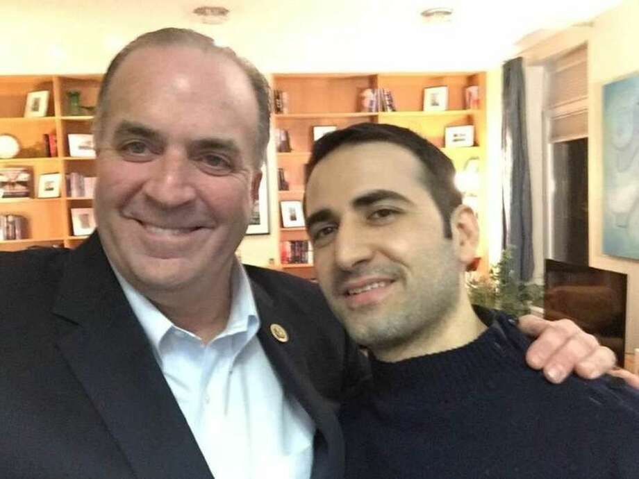 In a Monday, Jan. 18, 2016 photo provided by the Hekmati family, U.S. Rep. Dan Kildee, D-Flint Township, Mich., meets with former Iran prisoner Amir Hekmati at Landstuhl Regional Medical Center in Landstuhl, Germany. Hekmati was detained in August 2011 on espionage charges. Kildee told reporters that he's been working to free Hekmati and couldn't wait to meet him in person. (Courtesy of the Hekmati Family via AP)