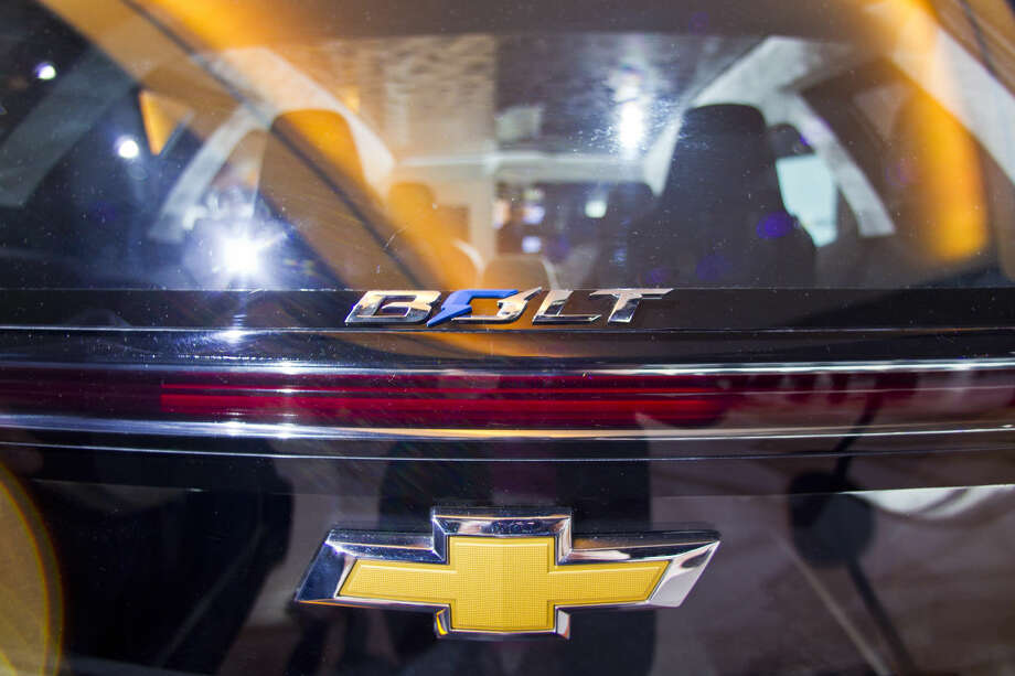 The rear hatch of the Chevrolet Bolt EV electric concept vehicle, featuring two-piece glass panels, on display during the North American International Auto Show, Monday, Jan. 12, 2015, in Detroit. (AP Photo/Tony Ding)