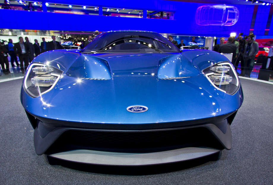 The bonnet of the new Ford GT supercar, on display at the North American International Auto Show, Monday, Jan. 12, 2015, in Detroit. (AP Photo/Tony Ding)