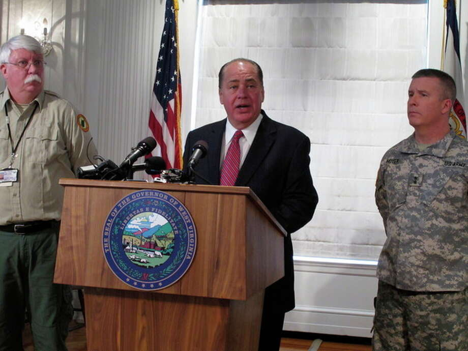 West Virginia Gov. Earl Ray Tomblin discusses the chemical spill that led to state of emergency and water ban in the state capital and surrounding areas on Friday, Jan. 10, 2014, in Charleston, W.Va. (AP Photo/Brendan Farrington) / AP