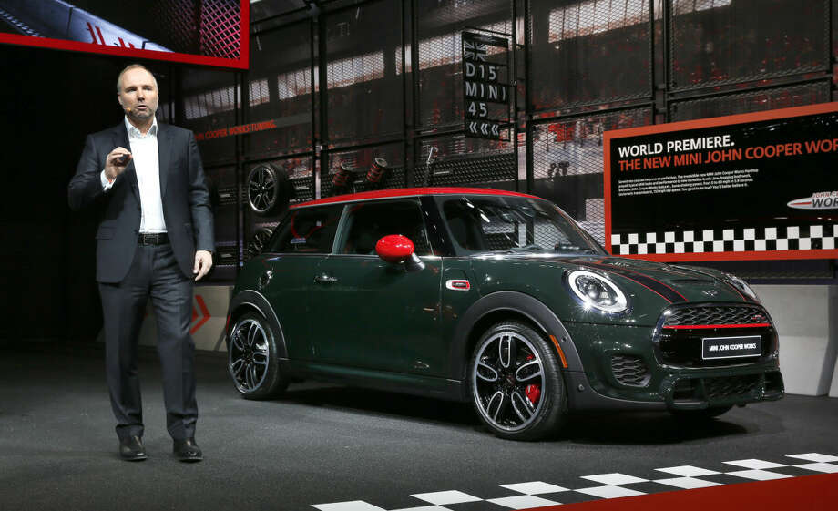 Jochen Goller, Senior Vice President, Mini, introduces the John Cooper Works hardtop at media previews for the North American International Auto Show in Detroit Monday, Jan. 12, 2015. (AP Photo/Paul Sancya)