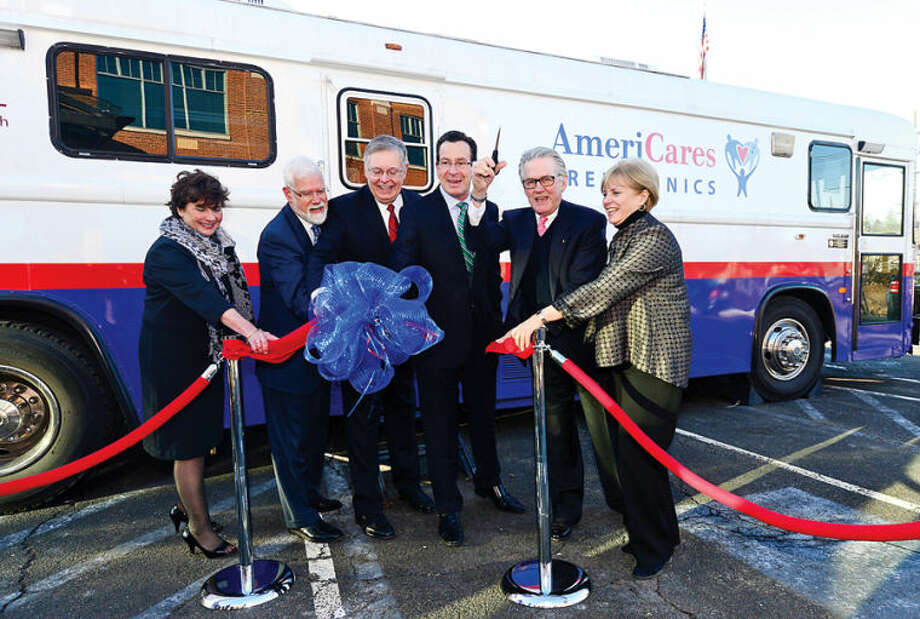 Stella Smith of Quest Diagnostics, David Smith of Stamford Hospital, Stamford Mayor David Martin, Gov. Dannel P. Malloy and Karen Gottlieb, Executive Director of AmeriCares Free Clinic attend a Ribbon Cutting and Opening Celebration for the AmeriCares Free Clinic of Stamford. The mobile clinic will serve low-income residents of Stamford and Darien ages 18 and older without health insurance.