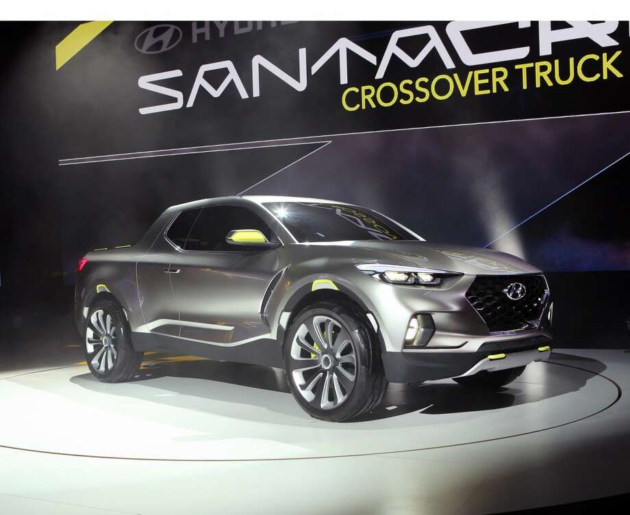 Detroit - January 12, 2015 - Hyundai today revealed its innovative Santa Cruz Crossover Truck Concept at the North American International Auto Show. Santa Cruz Concept combines truck-bed flexibility with the crossover utility. The Santa Cruz Crossover Truck Concept features an innovative tailgate extension that allows bed length to be expanded to a wide range of cargo types and sizes. Its unique, bold design, oversized wheels, five-passenger seating and environmentally-friendly 2.0-liter turbo diesel powertrain appeals to 'Urban Adventurer' Millennial lifestyles. (PRNewsFoto/Hyundai Motor America)