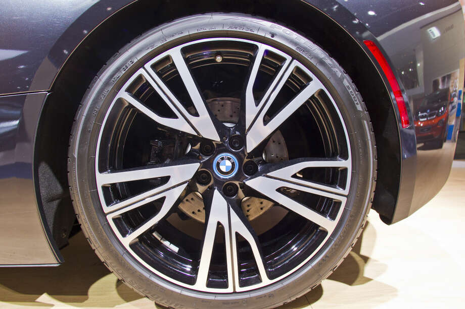 A wheel of a BMW i8 hybrid sports car, on display at the North American International Auto Show, Monday, Jan. 12, 2015, in Detroit. (AP Photo/Tony Ding)