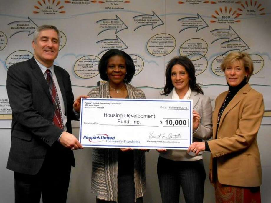 Pictured from left to right: Vincent Santilli, executive director of People's United Community Foundation; Joanne Taylor, chief operating officer of the Housing Development Fund; Karen Galbo, marketing, public and community relations director for People's United Community Foundation; and Valerie Senew, greater Fairfield County growth manager for People's United Bank. The foundation recently awarded a $10,000 grant to the Housing Development Fund in Stamford.