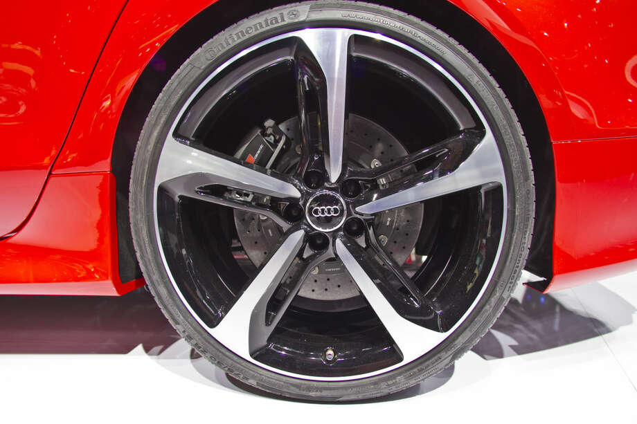A wheel of an Audi RS7 sedan, on display at the North American International Auto Show, Monday, Jan. 12, 2015, in Detroit. (AP Photo/Tony Ding)