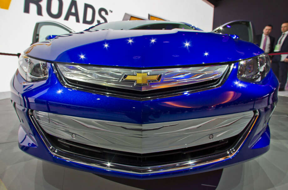 The bonnet of the 2016 Chevrolet Volt, on display at the North American International Auto Show, Monday, Jan. 12, 2015, in Detroit. (AP Photo/Tony Ding)