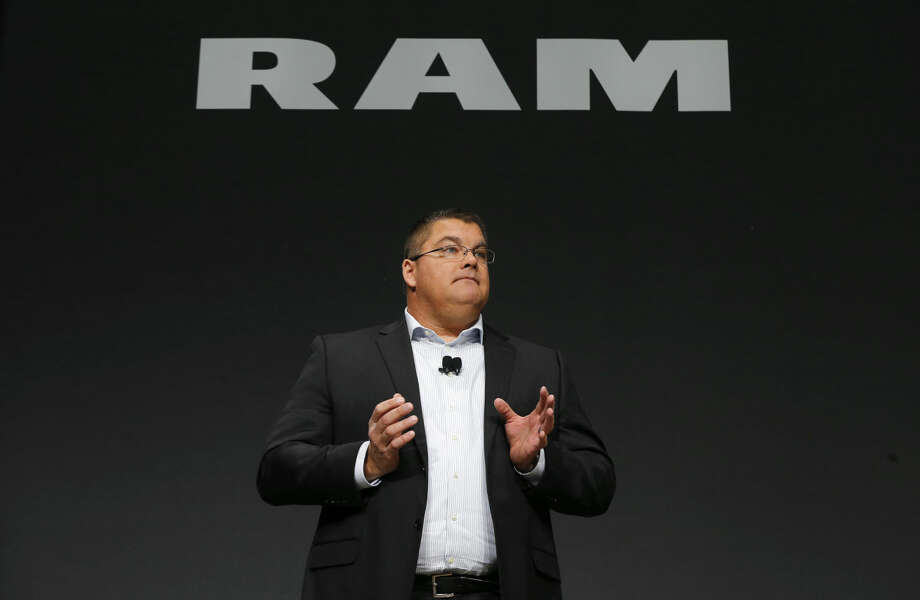 Bob Hegbloom, President and CEO, Ram Truck brand, introduces the Ram Rebel during media previews for the North American International Auto Show in Detroit, Tuesday, Jan. 13, 2015. (AP Photo/Paul Sancya)