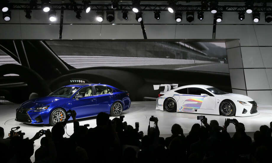 The Lexus GS F, left, and RC F GT3 debut during media previews for the North American International Auto Show in Detroit, Tuesday, Jan. 13, 2015. (AP Photo/Paul Sancya)