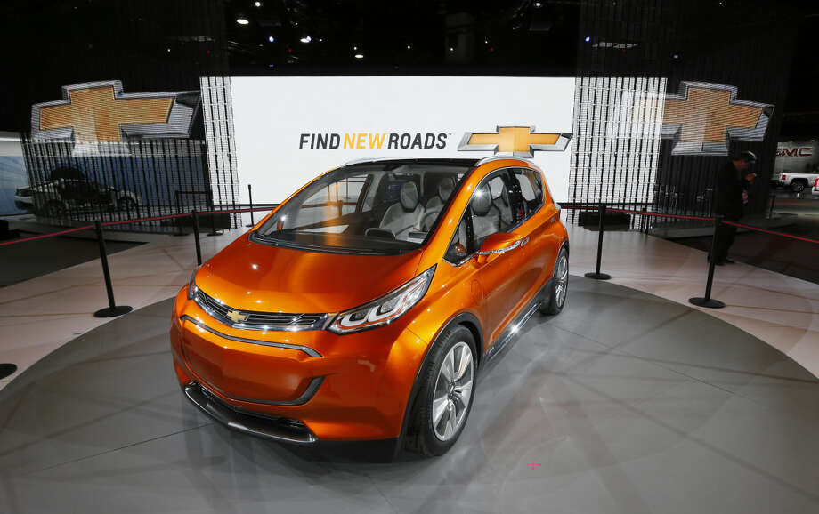 The Chevrolet Bolt is on display during media previews for the North American International Auto Show in Detroit, Tuesday, Jan. 13, 2015. (AP Photo/Paul Sancya)