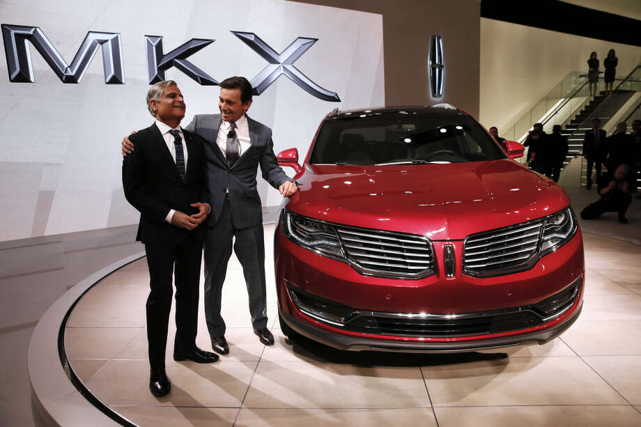 Kumar Galhotra, President of Lincoln, left, and Mark Fields, President and CEO, Ford Motor Company, pose with the Lincoln MKX during media previews for the North American International Auto Show in Detroit, Tuesday, Jan. 13, 2015. (AP Photo/Paul Sancya)