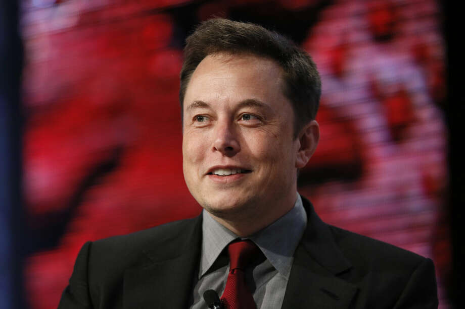 Elon Musk, Tesla Chairman, Product Architect and CEO, speaks at the Automotive News World Congress in Detroit, Tuesday, Jan. 13, 2015. (AP Photo/Paul Sancya)