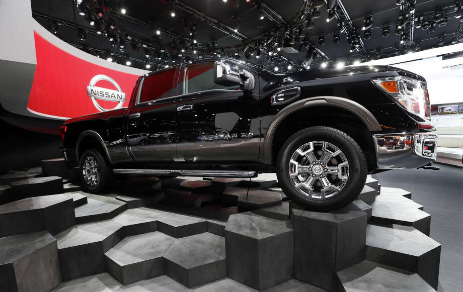 The Nissan Titan is on display during media previews for the North American International Auto Show in Detroit, Tuesday, Jan. 13, 2015. (AP Photo/Paul Sancya)