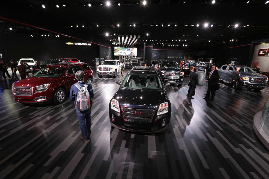 People walk through the GMC area during the 2015 North American International Auto Show, Tuesday, Jan. 13, 2015 in Detroit. (AP Photo/Detroit Free Press, Ryan Garza) DETROIT NEWS OUT; NO SALES