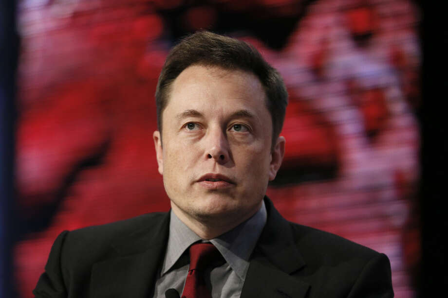 Elon Musk, Tesla Chairman, Product Architect and CEO, speaks at the Automotive News World Congress in Detroit Tuesday, Jan. 13, 2015. (AP Photo/Paul Sancya)