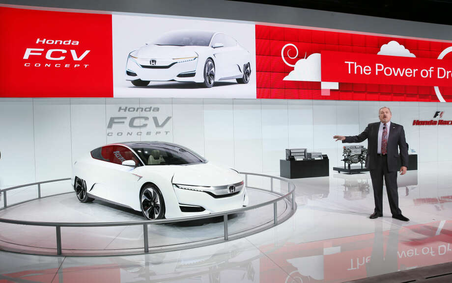 John Mendel, Executive Vice President, American Honda Motor Co., Inc. talks about the FCV Concept during media previews for the North American International Auto Show in Detroit, Tuesday, Jan. 13, 2015. (AP Photo/Paul Sancya)