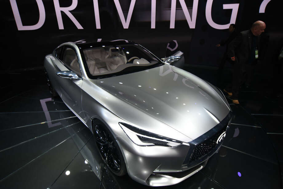 The Infiniti Q60 concept car is presented during media previews for the North American International Auto Show in Detroit, Tuesday, Jan. 13, 2015. (AP Photo/The Grand Rapids Press, Tanya Moutzalias) ALL LOCAL TELEVISION OUT; LOCAL TELEVISION INTERNET OUT