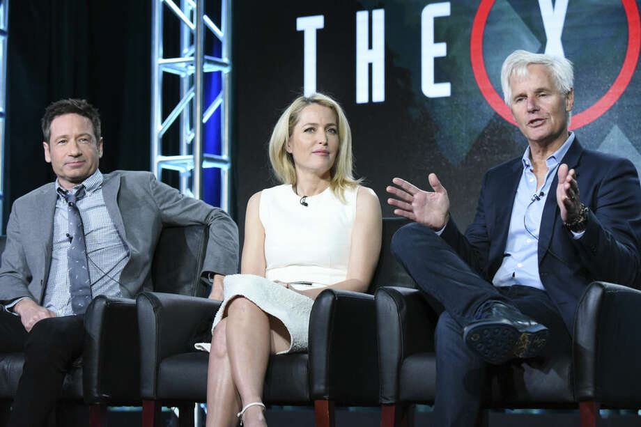 """Photo by Richard Shotwell/Invision/AP, FileIn this Friday, Jan. 15, file photo, actors David Duchovny, from left, Gillian Anderson and creator/executive producer Chris Carter participate in """"The X Files"""" panel at the Fox Winter TCA in Pasadena, Calif."""