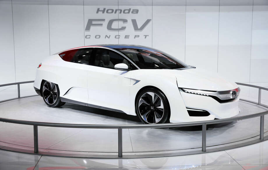 The Honda FCV Concept is displayed during media previews for the North American International Auto Show in Detroit, Tuesday, Jan. 13, 2015. (AP Photo/Paul Sancya)