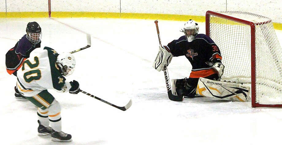 Trinity's Dareios Linss (20) beats Stamford-westhill goalkeeper Connor McDonough for a second period goal.