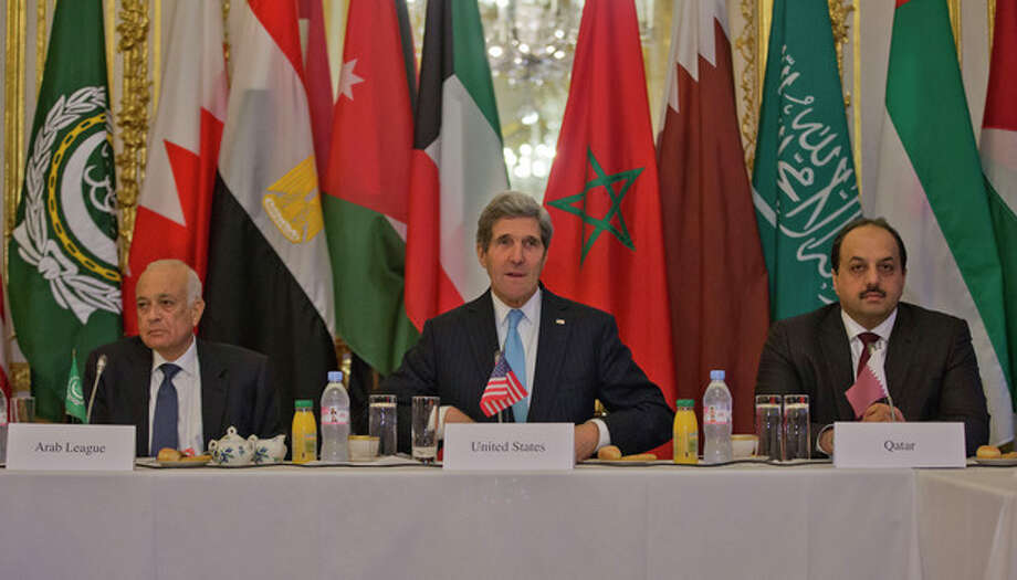 US Secretary of State, John Kerry, center, with Arab League Secretary General Nabil Elaraby, left, and Qatar's Foreign Minister Khalid bin Mohamed Al-Attiyah, right, before the start of a meeting with representatives of the Arab League at the US Ambassador's residence in Paris, France, Sunday, Jan. 12, 2014. Kerry is in Paris to attend a two-day meeting on Syria to rally international support for ending the three-year civil war. (AP Photo/Pablo Martinez Monsivais, Pool) / AP Pool