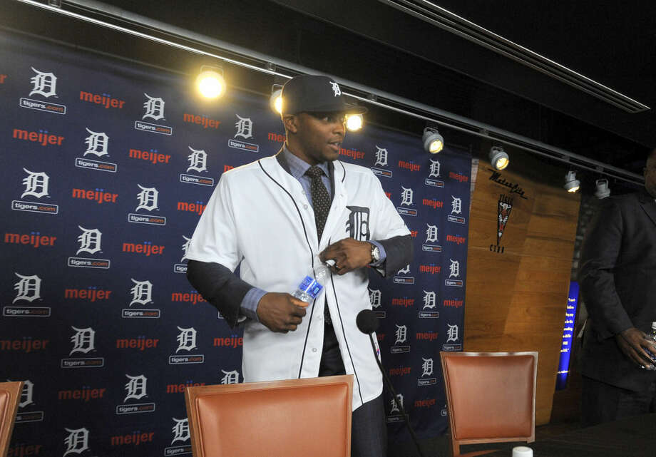 In this Jan. 20, 2016, photo, new Detroit Tigers outfielder Justin Upton wears a Tigers jersey during a press conference at Comerica Park in Detroit, Mich. (Steve Perez/Detroit News via AP) DETROIT FREE PRESS OUT; HUFFINGTON POST OUT; MANDATORY CREDIT
