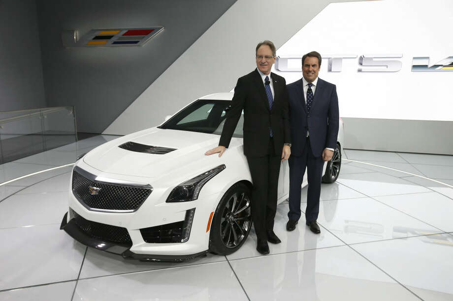 Johan de Nysschen, left, President of Cadillac and Mark Reuss, Executive Vice President, Global Product Development pose with the 2016 Cadillac CTS V at media previews for the North American International Auto Show in Detroit Tuesday, Jan. 13, 2015. (AP Photo/Paul Sancya)