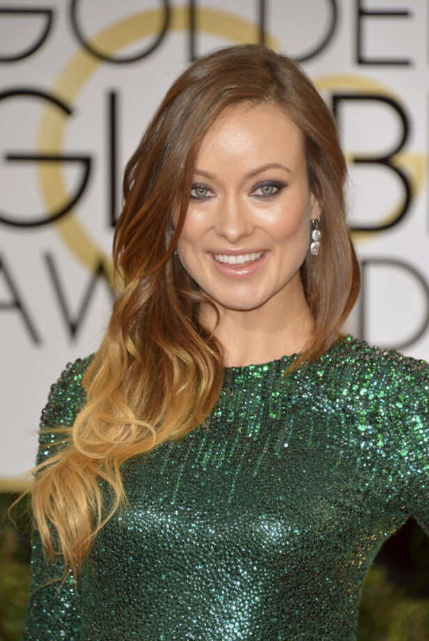 Olivia Wilde arrives at the 71st annual Golden Globe Awards at the Beverly Hilton Hotel on Sunday, Jan. 12, 2014, in Beverly Hills, Calif. (Photo by John Shearer/Invision/AP)