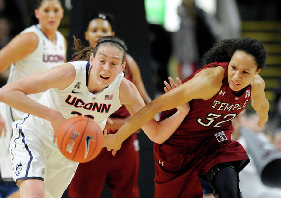 Connecticut's Breanna Stewart, left, and Temple's Natasha Thames (32) fight for a loose ball during the first half of an NCAA college basketball game in Bridgeport, Conn., Saturday, Jan. 11, 2014. (AP Photo/Fred Beckham) / FR153656 AP